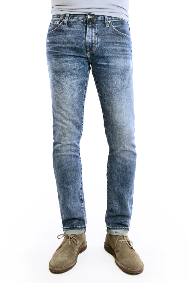 SMN Studio's Hunter in Rouge Men's Jeans - Slim fit jean in medium washed comfort stretch premium Japanese selvedge denim with fades, whiskering, honeycombs, and slight tears for a natural looking vintage wash