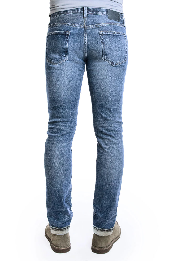 Back of SMN Studio's Hunter in Rouge Men's Jeans - Slim fit jean in medium washed comfort stretch premium Japanese selvedge denim with fades, whiskering, honeycombs, and slight tears for a natural looking vintage wash