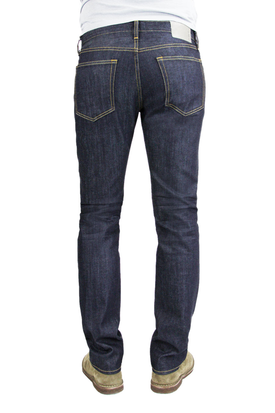 Back of S.M.N Studio's Bond in Bravo Men's Jeans. A slim straight raw denim washed jean made in a comfort stretch pure indigo dyed Japanese denim.