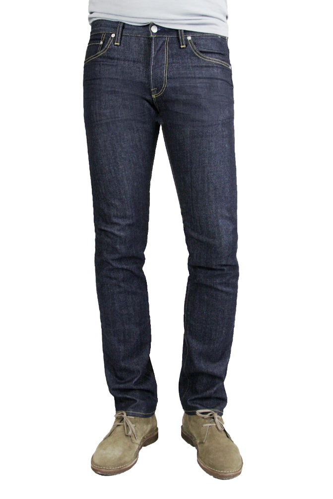 S.M.N Studio's Hunter in Bravo Men's Jeans - Slim fit jeans made with a comfort stretch raw denim wash treatment