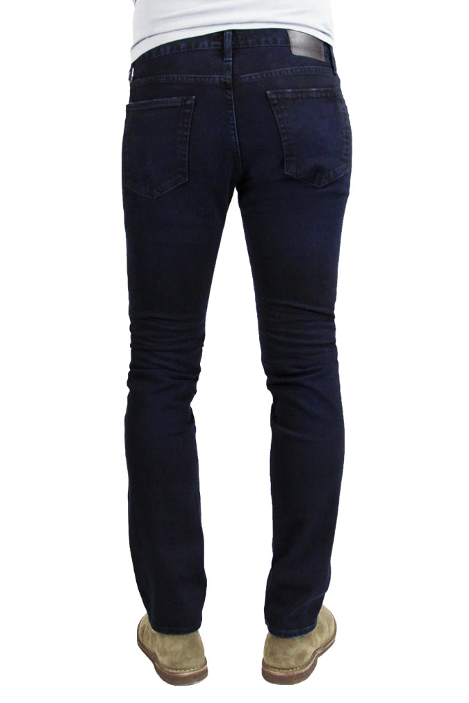 Back of S.M.N Studio's Hunter in Shadow Men's Jeans - A slim fit dark indigo washed jean in a comfort stretch denim