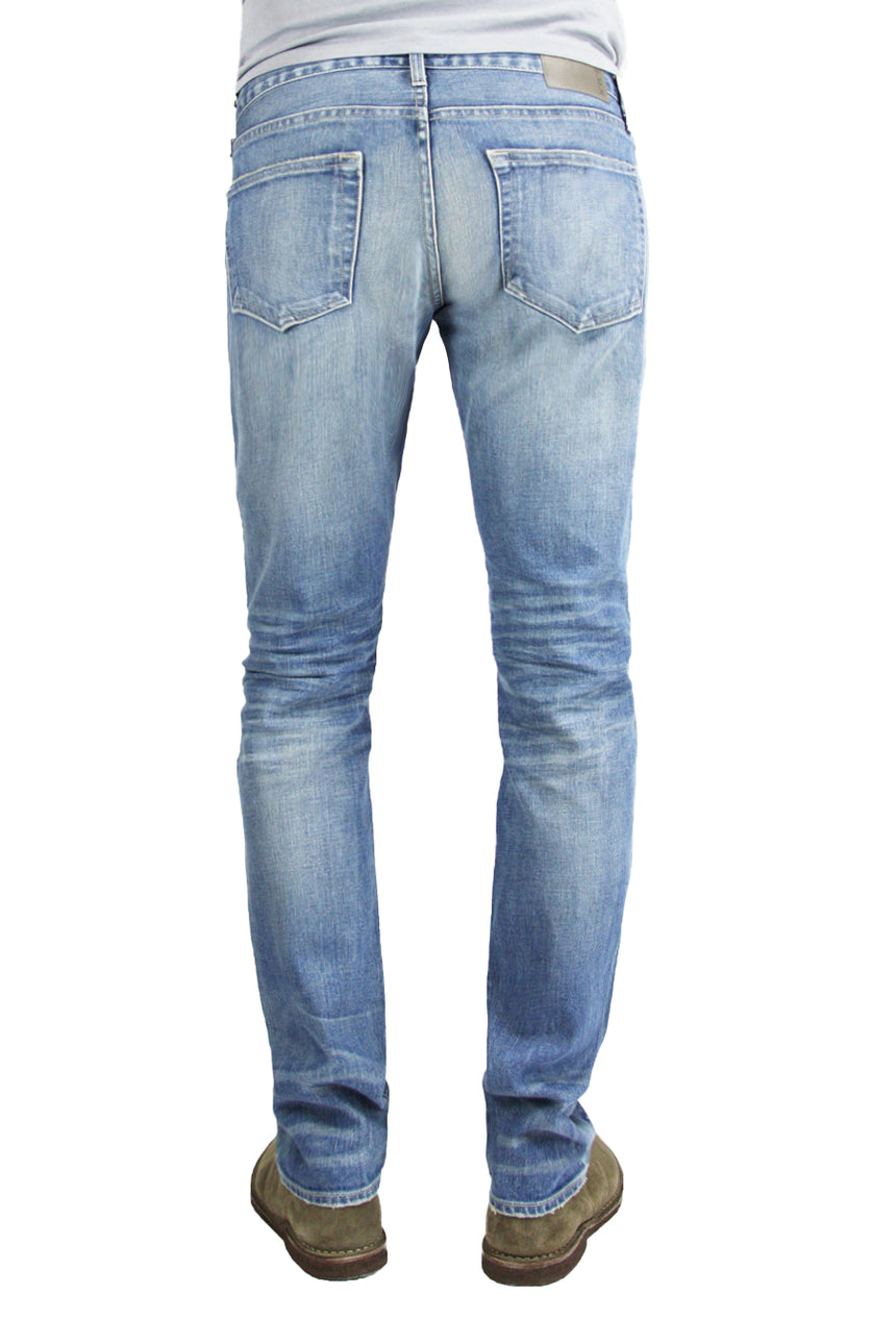 Back of S.M.N Studio's Finn in Western Men's Jeans - Tapered Slim Comfort Stretch Denim in vintage light wash denim accented with fading and whiskering