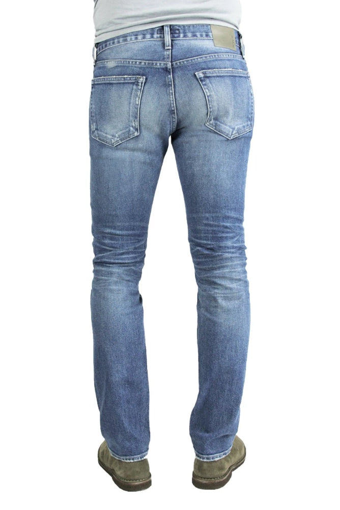 Back of S.M.N Studio's Hunter in Aspen Men's Jeans - Tapered Slim Comfort Stretch Selvedge Denim in vintage medium blue wash with contrasting fades and 3D whiskering