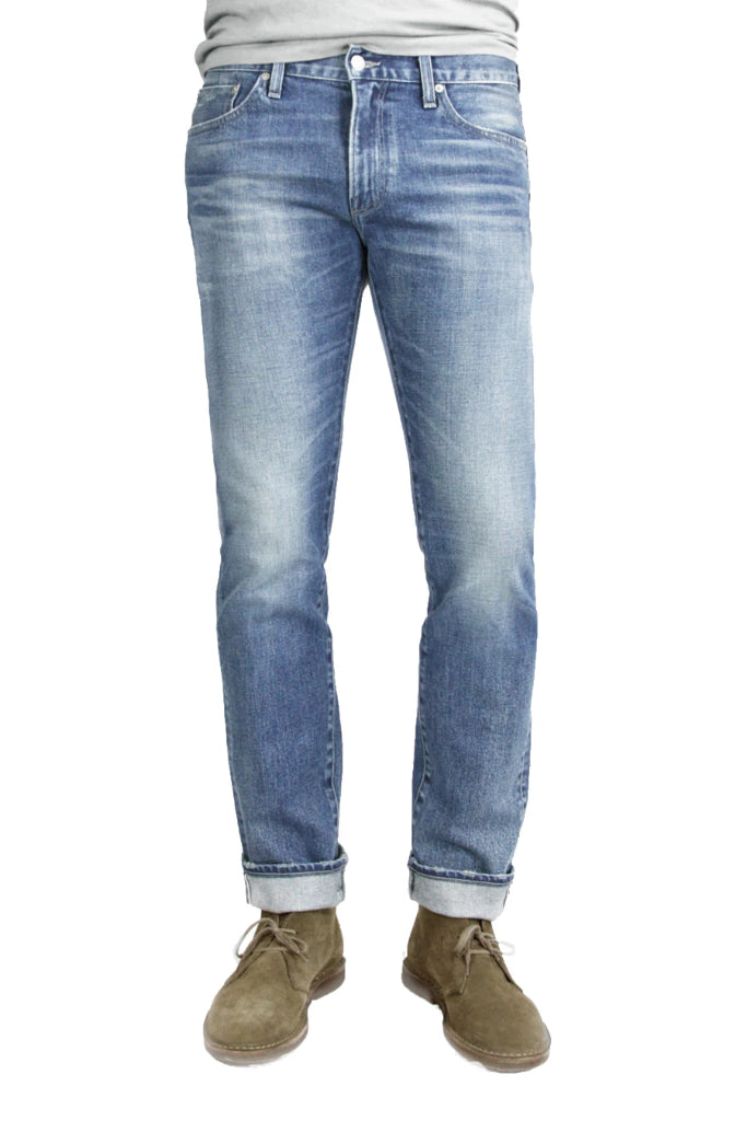 S.M.N Studio's Hunter in Aspen Men's Jeans - Tapered Slim Comfort Stretch Selvedge Denim in vintage medium blue wash with contrasting fades and 3D whiskering
