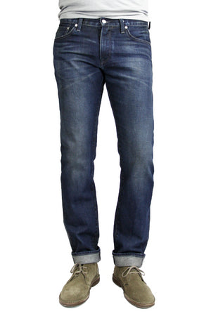 S.M.N Studio's Hunter in Ethan Men's Jeans - Slim fit in a dark indigo washed Japanese premium stretch selvedge denim and light contrast fading and whisker for a vintage appeal