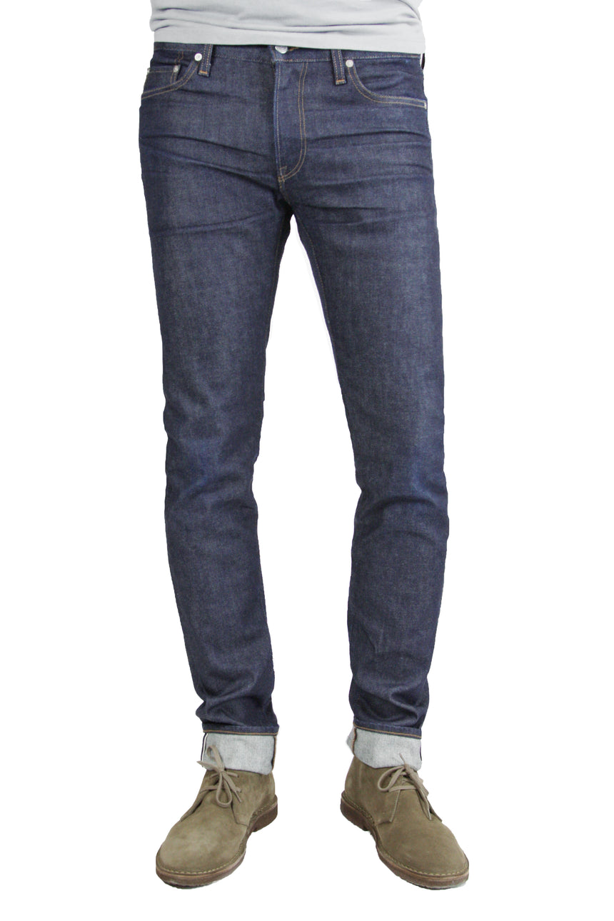 S.M.N Studio's Finn in Jace Men's Jeans. A tapered slim stretch selvedge jean in a raw denim wash made from a comfortable and premium Japanese stretch selvedge denim.