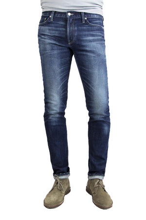 S.M.N Studio's Finn in Matteo Men's Jeans - Tapered slim fit jean in comfort stretch premium Japanese selvedge denim in a dark blue wash with contrasting fades