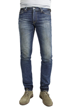 S.M.N Studio's Finn in Harvey Men's Jeans - Tapered slim fit comfort stretch jeans with a rugged vintage look in a dark indigo wash, fading, and slight tear details