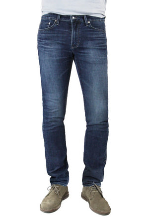 S.M.N Studio's Hunter in Linden Men's Jeans - A slim fit dark indigo washed denim lightly contrasted with fading, whiskering, and honeycombs for a slight worn-in look.