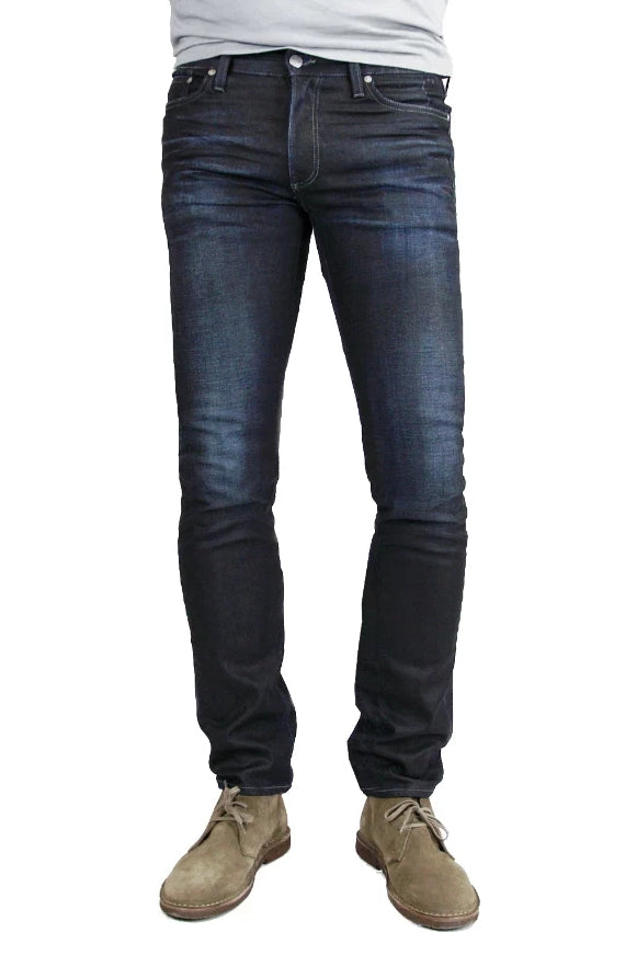 S.M.N Studio's Hunter in Empire Men's Jeans - Slim fit jeans made up in a premium comfort stretch denim with a dark indigo wash characterized by light contrast fades, accented 3D whiskers, and honeycombs