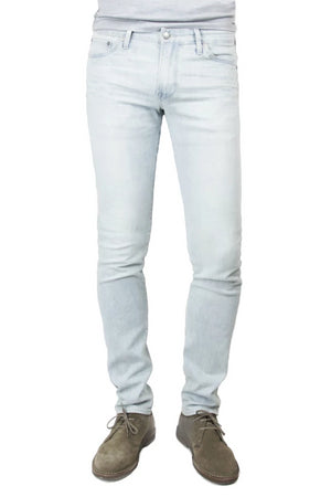 S.M.N Studio's Finn in Dusk Men's Jeans. A tapered slim light blue wash jean made in a comfort stretch Japanese denim.