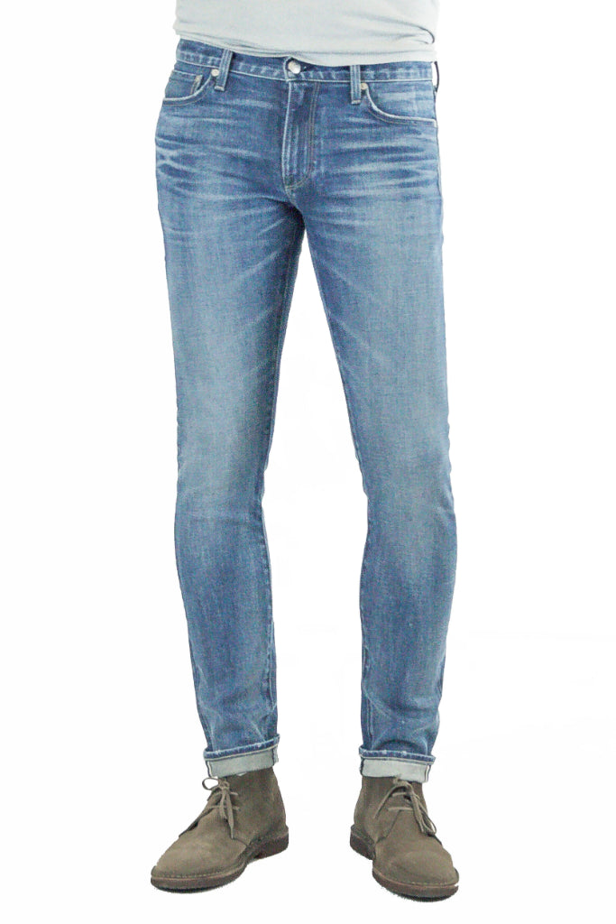 S.M.N Studio's Finn in Eden Men's Jeans - Tapered slim stretch selvedge japanese denim in a medium indigo wash and finished with fading, 3D whiskering for a natural broken-in look