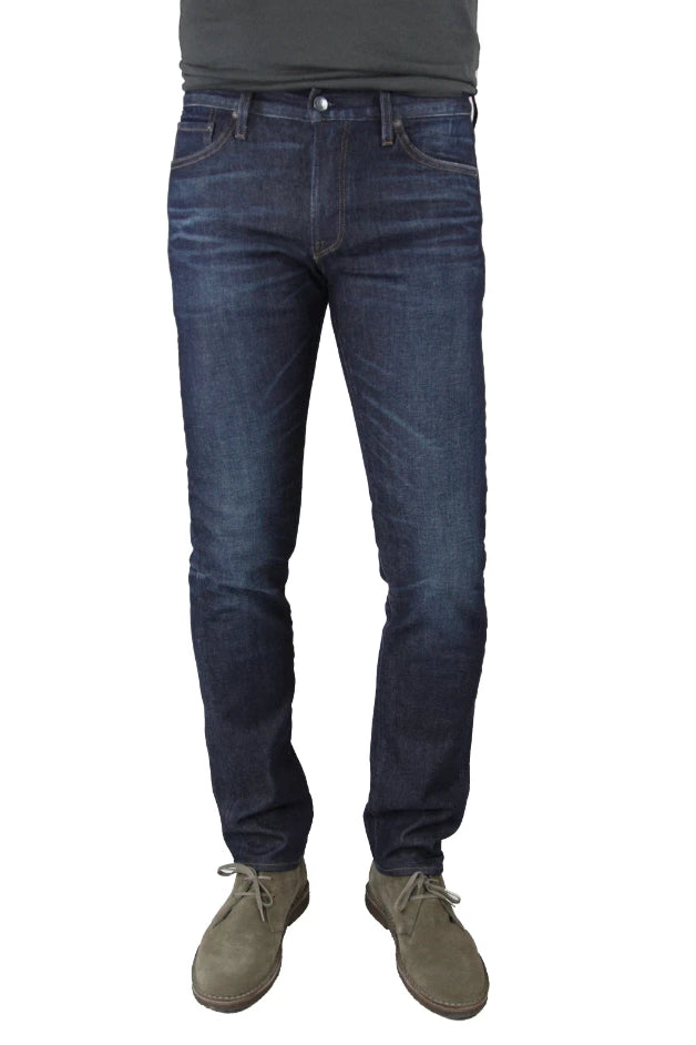 S.M.N Studio's Hunter in Dean Men's Jeans - Slim fit jeans in a dark indigo denim wash with slight contrast fades, 3d whiskering, and honeycombs to replicate a natural worn look