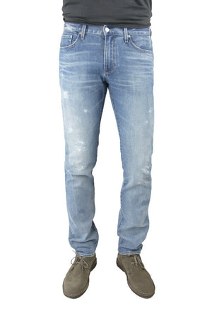 S.M.N Studio's Hunter in Zinc Men's Jeans -  Slim fit light indigo washed denim faded with light rip details on thigh and in comfort stretch denim