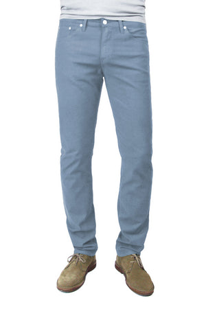 S.M.N Studio's Hunter in Sky Men's Twill Pants. A slim fit comfort stretch twill pant made up in a light blue grey color.