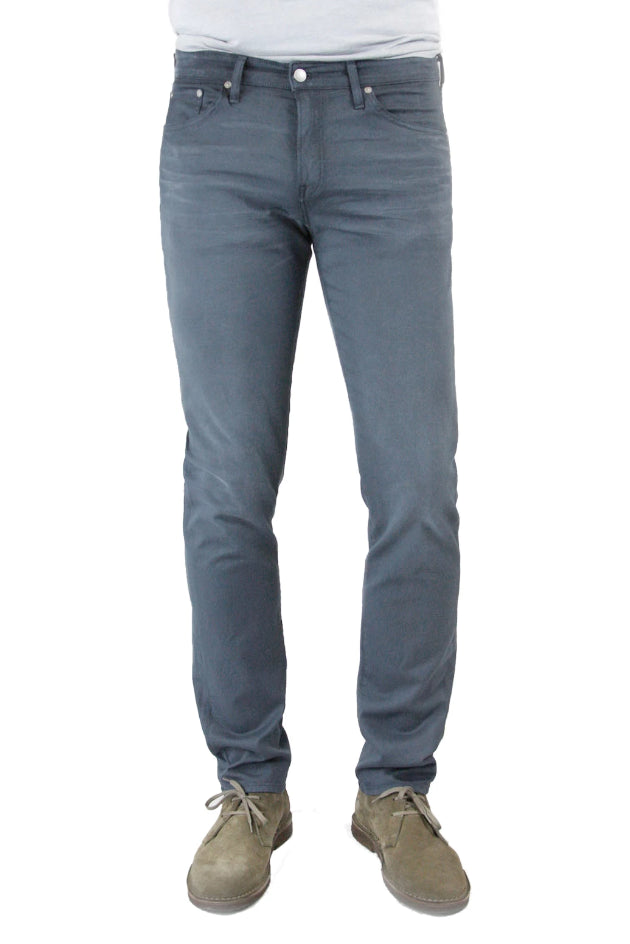 S.M.N Studio's Hunter in Vintage Slate Men's Jeans. A standard slim stretch comfort twill pant in a dark navy color with a washed vintage aesthetic