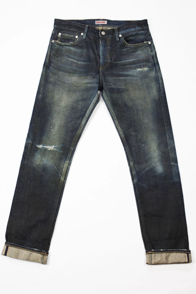 Flat image of S.M.N Studio's Mercer in Deliverance Men's Jeans - A vintage inspired dark washed slim fit jean made in 100% Japanese cotton selvedge with fading and rips