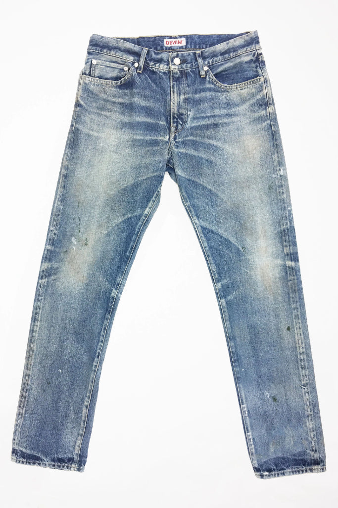 Flat image of S.M.N Studio's Mercer in Emerson Men's Jeans - Slim Fit Light vintage washed 100% Japanese Cotton selvedge denim with fading and splattering to create a truly workwear inspired pair