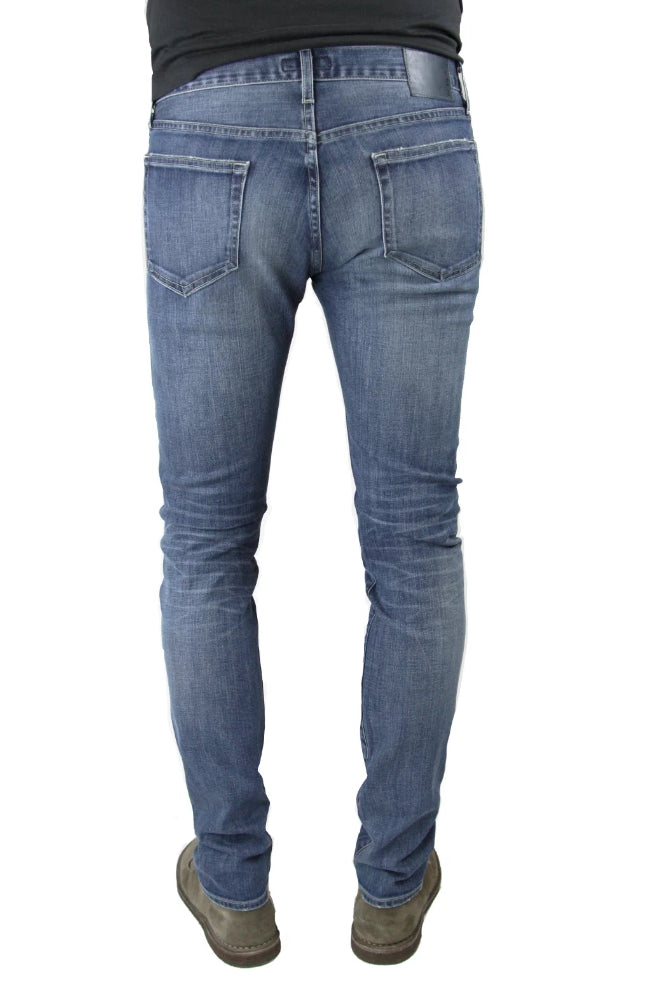 Back of S.M.N Studio's Hunter in Archer Men's Jeans - Slim fit jeans in a comfort Stretch Denim that has a medium wash highlighted by slight contrast fades and 3D whiskers