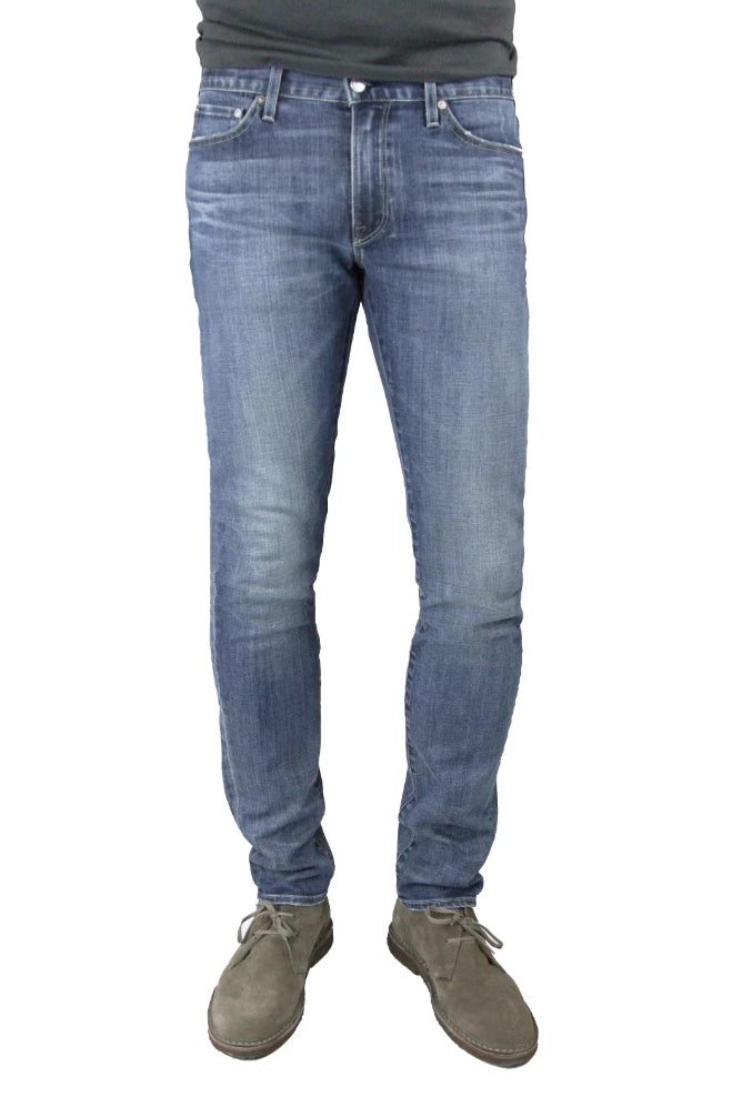 S.M.N Studio's Hunter in Archer Men's Jeans - Slim fit jeans in a comfort Stretch Denim that has a medium wash highlighted by slight contrast fades and 3D whiskers