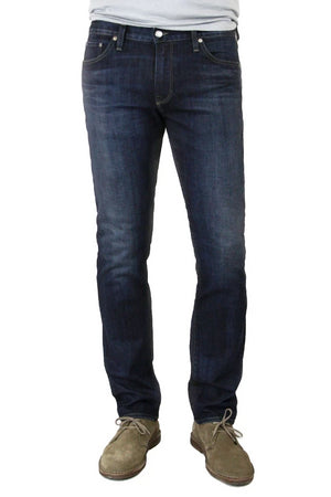 S.M.N Studio's Hunter in Bowery Men's Jeans. Slim dark blue washed stretch jeans with lightly accenting contrast fades.