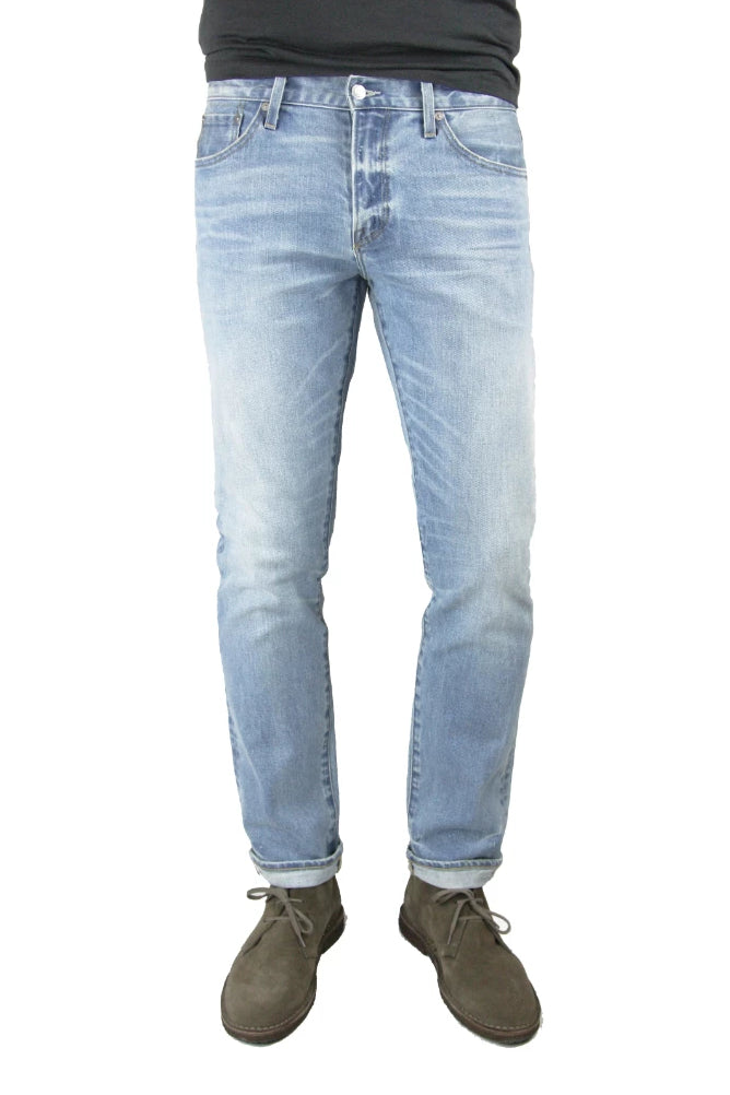 S.M.N Studio's Finn in Koi Men's Jeans. A tapered slim stretch selvedge jean in a light blue wash denim made from a comfortable and premium Japanese stretch selvedge denim.