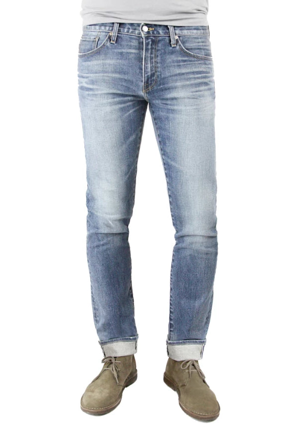 S.M.N Studio's Hunter in Phoenix - Men's slim fit light vintage indigo washed stretch selvedge denim with fading and whiskering
