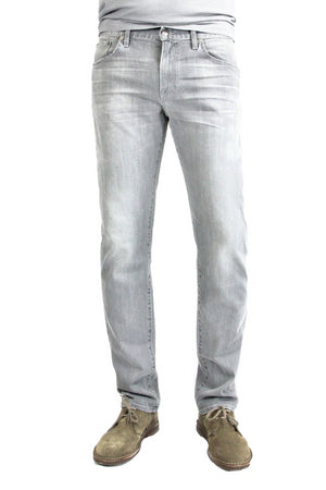 S.M.N Studio's Hunter in Owen - Men's slim fit jeans made with a comfortable stretch and in a lighter grey wash also contrasted with fading, 3D whiskers, and honeycombs