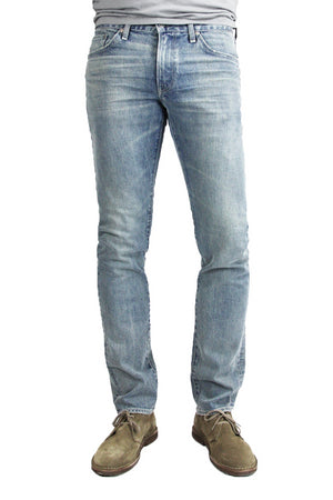 S.M.N Studio's Hunter in Vernon Men's Jeans - A light blue slim fit vintage washed jean with fading. The color is almost a light grey.