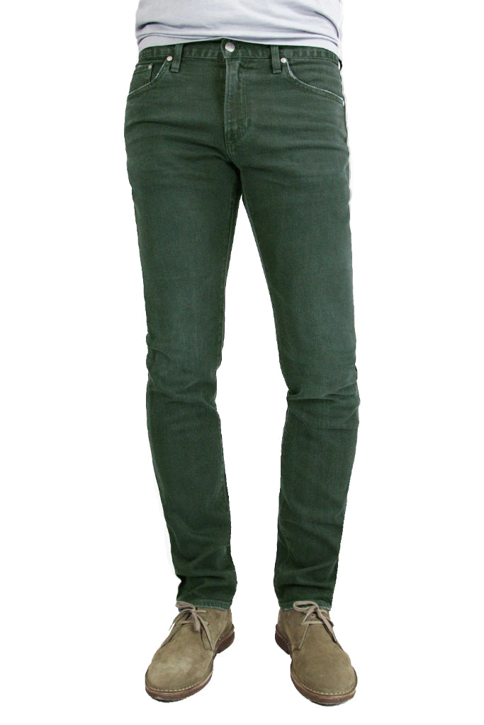 S.M.N Studio's Finn in Forest Men's Jeans - A tapered slim fit men's jean dyed in a forest green and made in premium stretch Japanese denim for slight contrast fades and whiskering for a lightly worn-in look