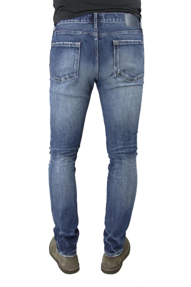 Back of S.M.N Studio's Finn in Diver Men's Jeans. A tapered slim fit medium wash jean in comfort stretch premium Japanese denim. The wash is contrasted with 3D whiskers and fading for a naturally vintage look.