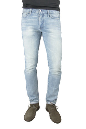 S.M.N Studio's Hunter in Dayton Men's Jeans - Slim fit jean made in 100% cotton Japanese selvedge in a light blue wash contrasted with fading and whiskering