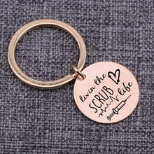 "Load image into Gallery viewer, ""Livin The Scrub Life"" Nurse Keychain"