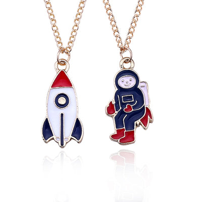 Astronaut and Rocket Enameled Pendant necklaces