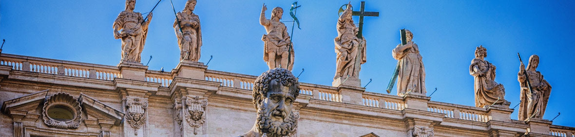 Apostle Saint Peter stands as stone statue in Italy with blue sky in background