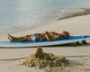 Father/Son, Anguilla,  Surfboard with sleeping man, Josh Welch
