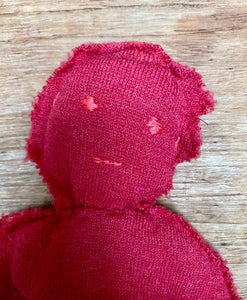 Red circulair doll made from a recycled pullover 100% wool