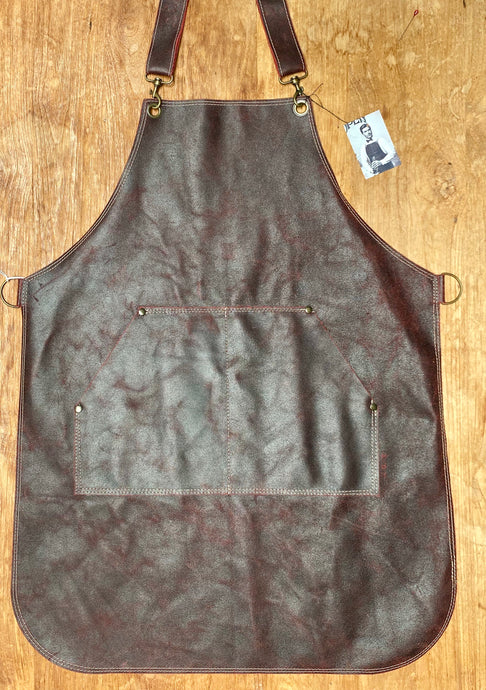 Leather apron in red.