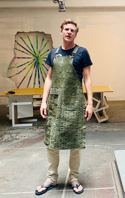 Up cycled green leather, green denim fabric. The fully recycled handmade apron.