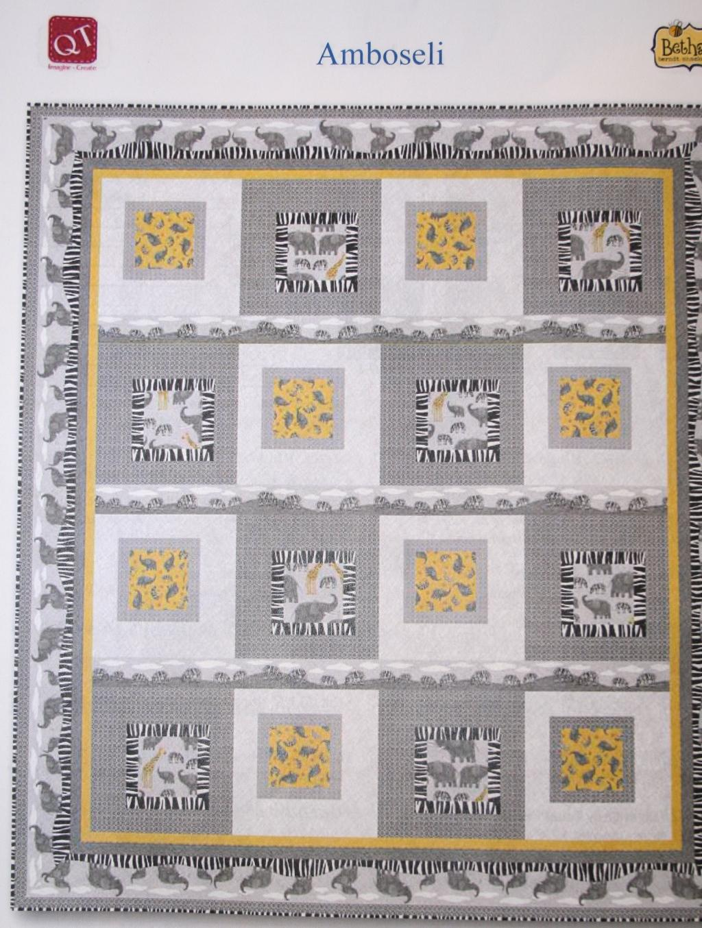 Elephants, zebras and giraffes in colors of black, gray, white and gold feature in this quilt.