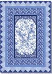 This kit has a panel in the center with birds and flowers.  Several borders in blue with flowers complete the quilt.