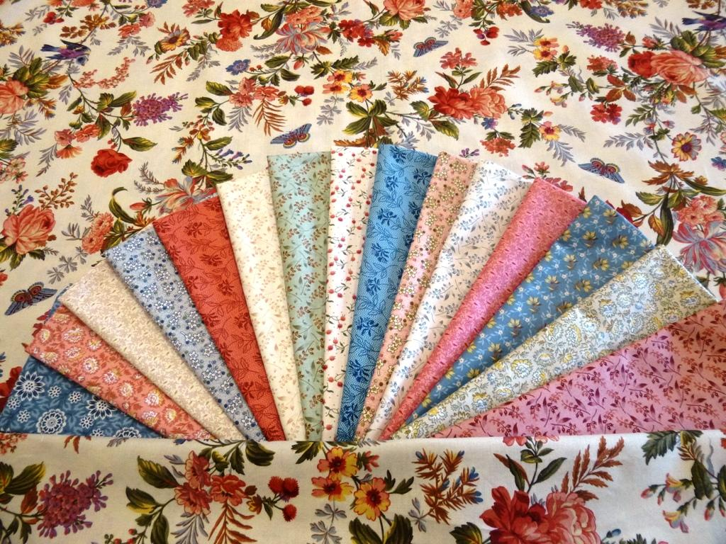 The fabrics in the kit are florals from the Bed of Roses collection.  The main colors are blue, mauve, cream and primrose.