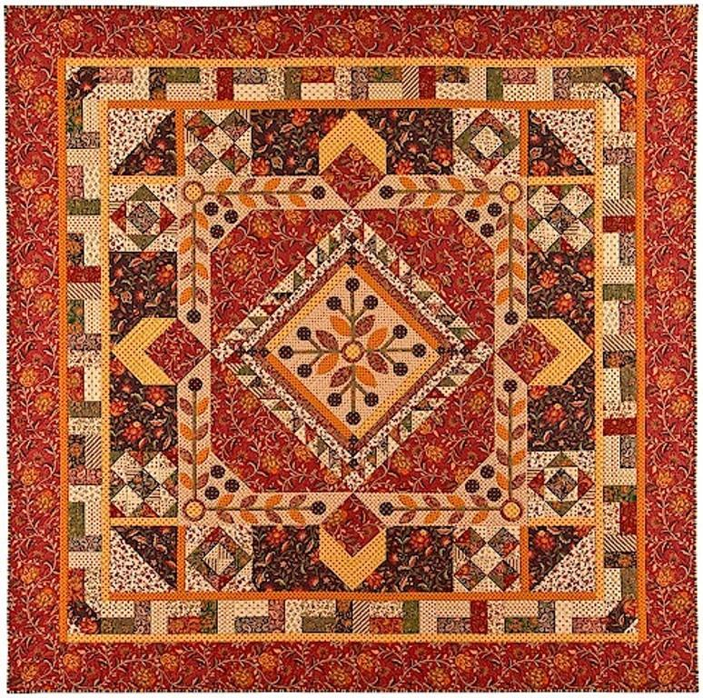 Block of the month quilt in colors of orange, green and brown. Flowers and leaves are appliqued.  Pieced blocks surround large medallion.