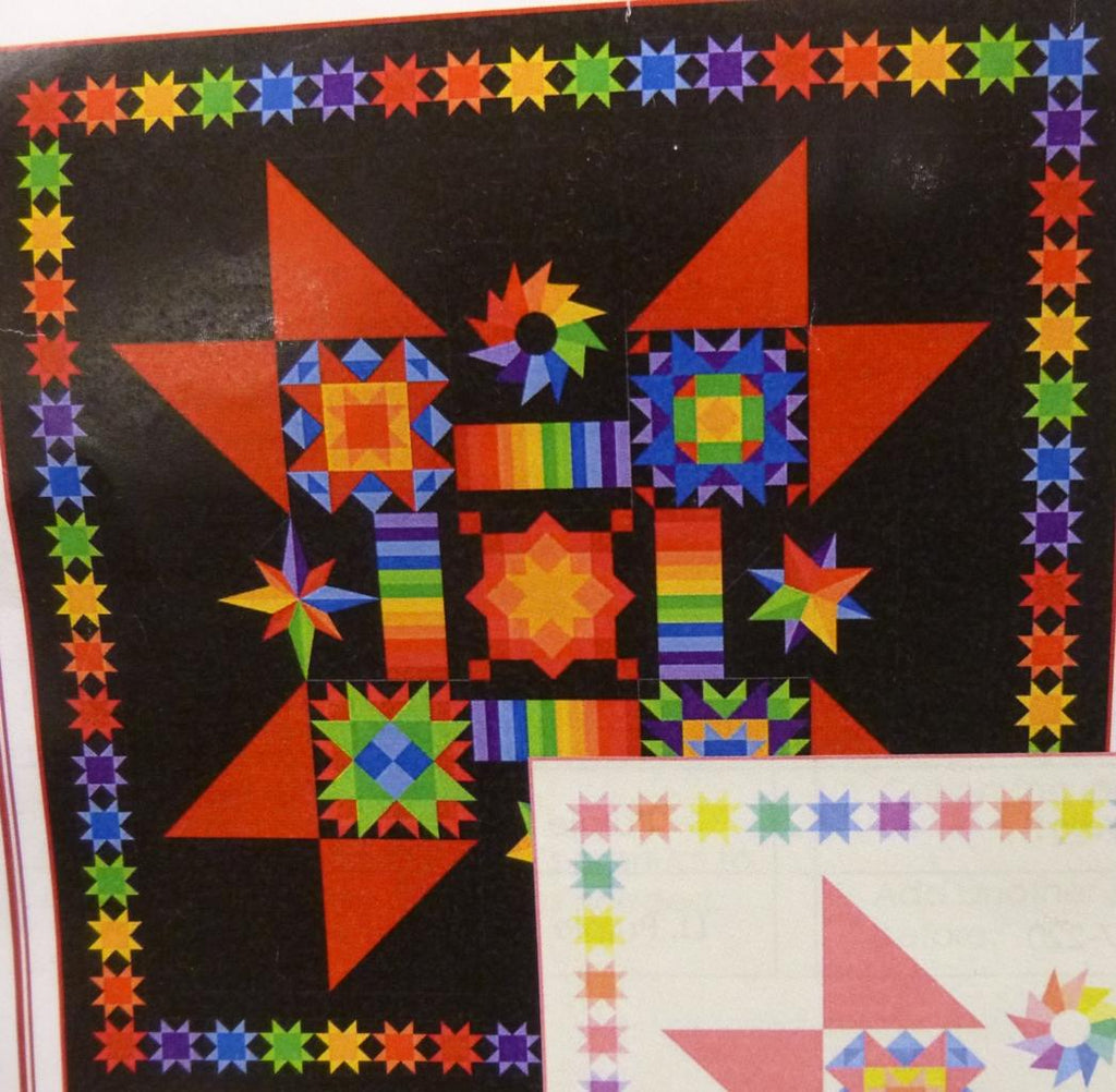 The black background make the colorful blocks jump off the quilt.  Red, blue, yellow, green and purple fabric make up the center star and small star border.