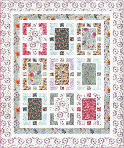 Several different floral fabrics make up this modern quilt.