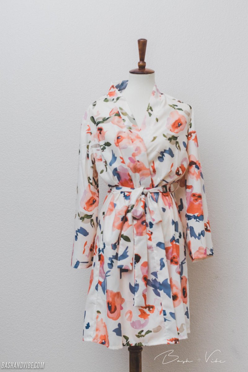 Floral bridesmaid robe on mannequin against white back drop.