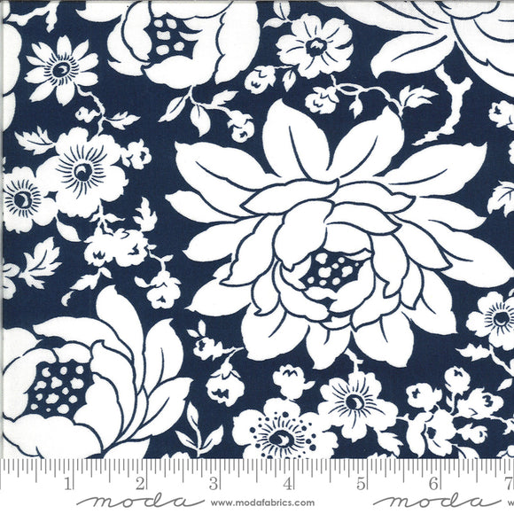Shine on Fabric designed by Bonnie & Camille for Moda Fabrics. Navy blue  background with large white floral print. Quilting cotton fabric.