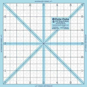 "Lori Holt Trim-It 6.5"" square quilting ruler."