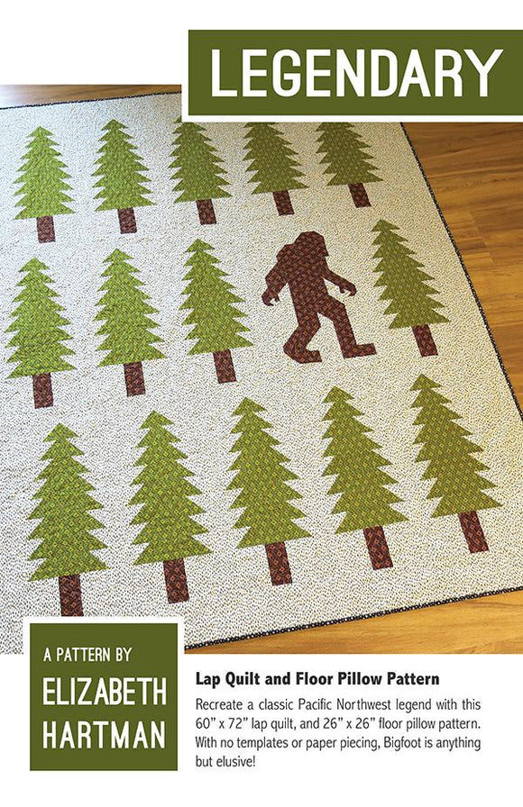 Legendary quilt pattern by Elizabeth Hartman depict a big foot Sasquatch walking through a forest of pine trees.