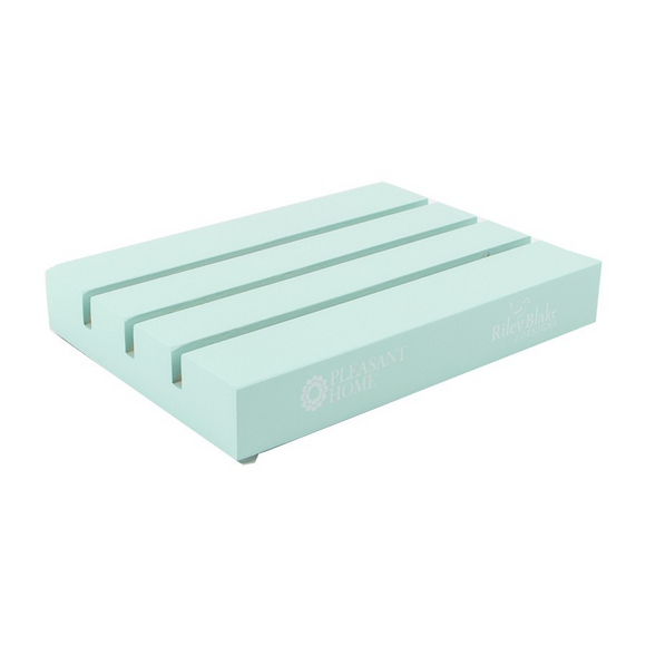 Ruler Pal mini is a painted piece of wood with shallow grooves made for holding quilting rulers.  Mint Color.  Designed by Pleasant Home for Riley Blake Designs.